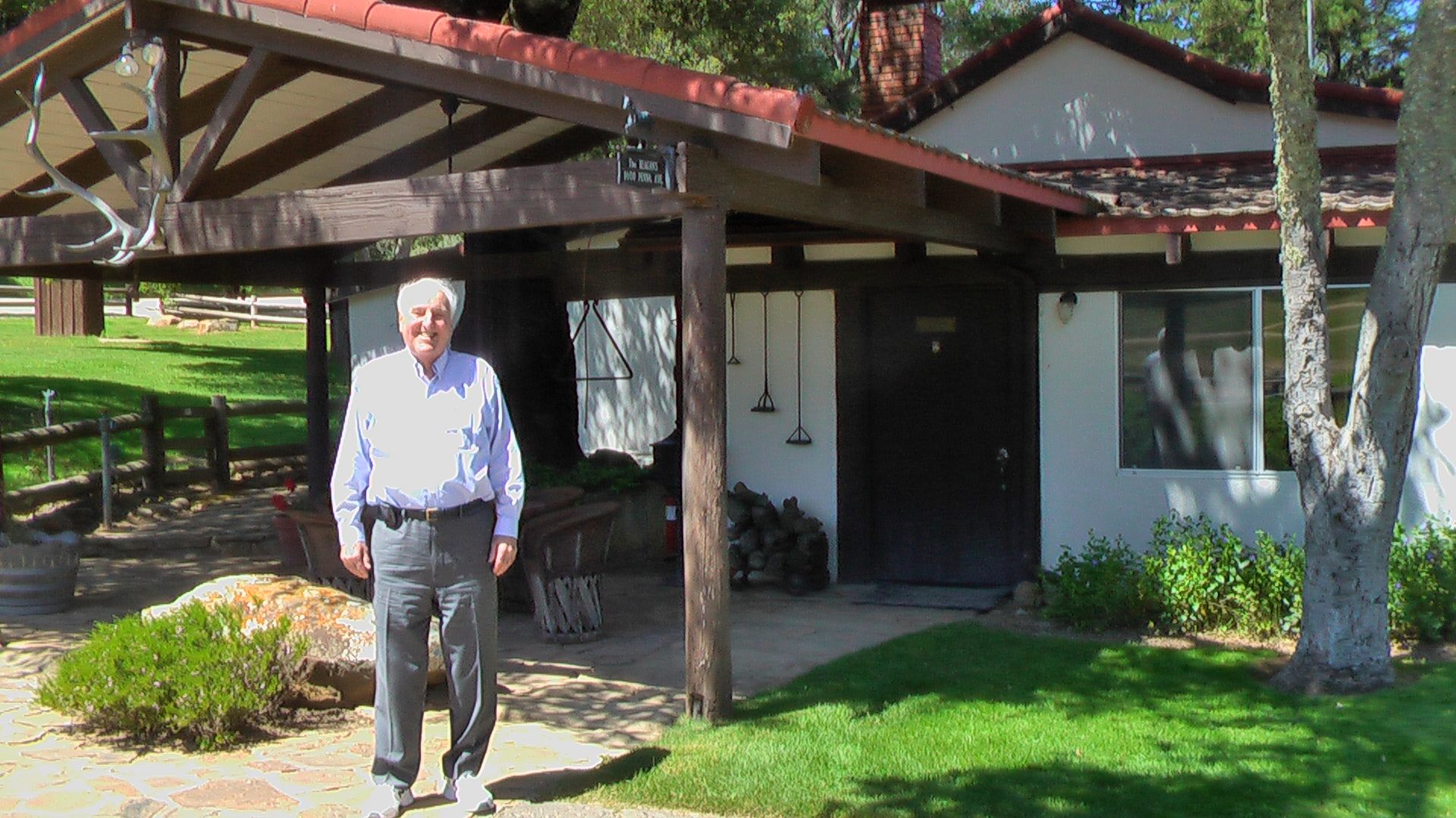 Donn dears in front of reagan ranch house