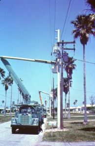 Overhead distribution line in Florida, with concrete poles.