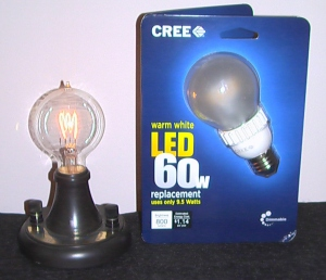 Replica of 1879 Edison bulb used by GE at its 100th anniversary, alongside a modern LED lamp.