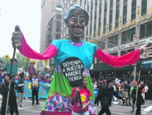 News photo of marchers demanding climate commitments in defense of Mother Earth